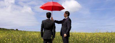 business man holding umbrella Baxley GA